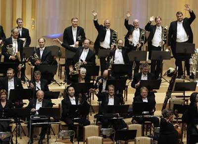 Members of the New York Phil wave
