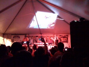 DJ duo NASA performs in the tent outside Emo's.